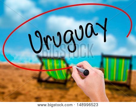 Man Hand Writing Uruguay  With Black Marker On Visual Screen