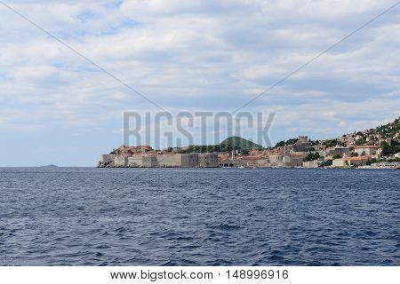View of Dubrovnik old town from Adriatic sea (Croatia). Space for text up and button.