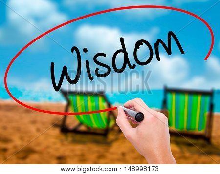 Man Hand Writing Wisdom With Black Marker On Visual Screen