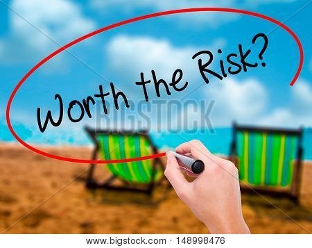 Man Hand Writing Worth The Risk? With Black Marker On Visual Screen