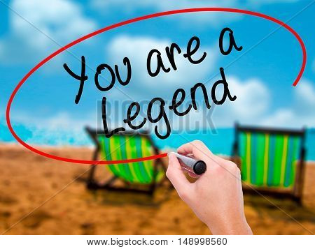 Man Hand Writing You Are A Legend   With Black Marker On Visual Screen