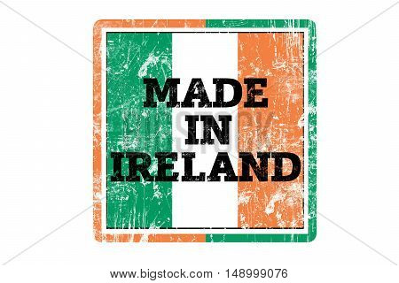 MADE IN IRELAND word written on red rubber stamp and flag with grunge edges.