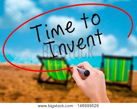 Man Hand Writing Time To Invent With Black Marker On Visual Screen