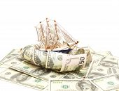 Sailing vessel on waves from dollars on a white background. poster