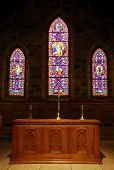 Church alter in front of beautiful stained glass windows poster