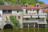 Old historic waterfront buildings in Rijeka Crnojevica Montenegro. poster