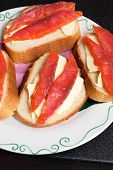Fresh wild salmon fish fillet steaks on a bread and butter poster