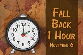 Daylight Savings Time message Some fall leaves and retro alarm clock with text Fall Back 1 Hour November 6 poster