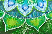 closeup of bright green painted picture with circle pattern mandala of anahata chakra poster