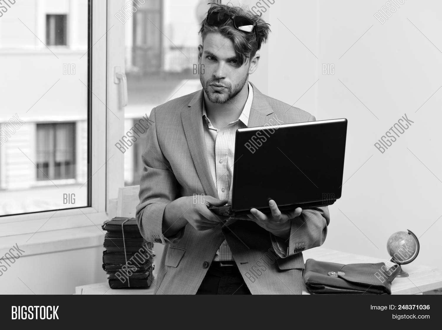 Magnificent Cool Guy Sits On Table Image Photo Free Trial Bigstock Download Free Architecture Designs Rallybritishbridgeorg
