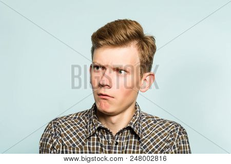 Amazed Astonished Shocked Dazed Impressed Stunned Man Looking Sideways. Portrait Of A Young Guy On L