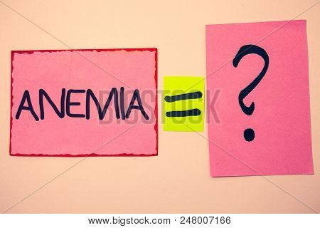 Handwriting text Anemia. Concept meaning Bloodlessness Disease Severe Blood Loss Illness Sick Iron Deficiency Ideas messages pink papers communicate intention equal sign question mark poster