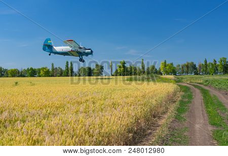 Summer Landscape With An Old Airplane Flying Over An Agricultural Field In Ukraine