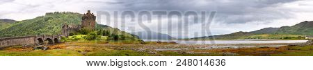Wide panorama of Eilean Donan Castle and Loch Duich in the Highlands of Scotland, UK