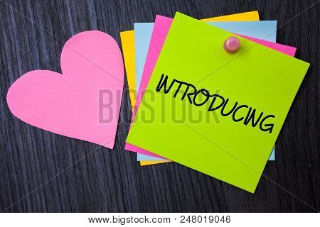 Writing Note Showing  Introducing. Business Photo Showcasing Presenting A Topic Or Someone Initial A