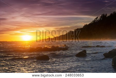 Seascape And Rocks In Sunset Time.
