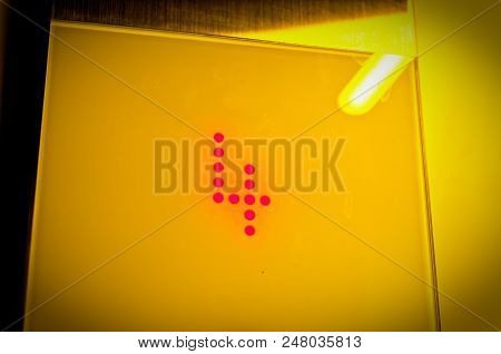 Elevator Display Of The Floor With The Number 4 In Yellow Optics