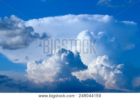 Beautiful White Clouds On Blue Sky Background. White Clouds On Boundless Sky. Blue Sky With White Cl