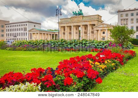 Classic View Of Famous Brandenburg Gate At Pariser Platz, One Of The Best-known Landmarks And Nation