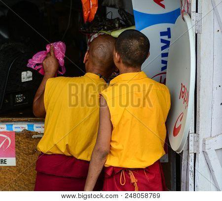 Bodhgaya, India - July 9, 2015. Buddhist Novice Monks On Street In Bodhgaya, India. Bodhgaya Is The