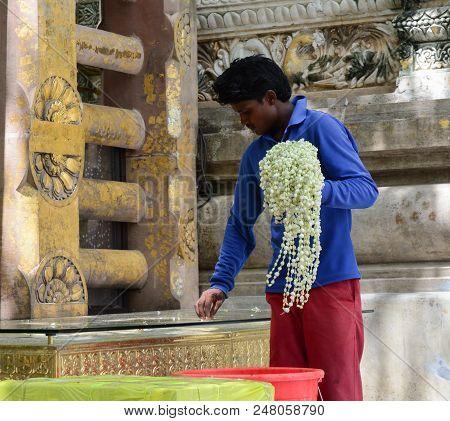 Bodhgaya, India - Jul 9, 2015. A Man Praying At Mahabodhi Temple Complex. The Mahabodhi Vihar Is A U