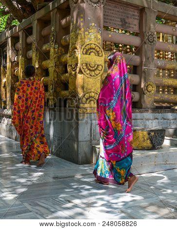 Bodhgaya, India - Jul 9, 2015. Local Women Walking At Mahabodhi Temple Complex. The Mahabodhi Vihar