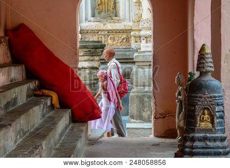 Bodhgaya, India - Jul 9, 2015. Prayers Walking At Mahabodhi Temple Complex. The Mahabodhi Vihar Is A
