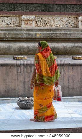 Bodhgaya, India - Jul 9, 2015. A Local Woman Walking At Mahabodhi Temple Complex. The Mahabodhi Viha