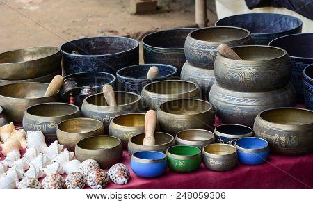 Bodhgaya, India - July 9, 2015. Singing Bowls Of Bronze For Sale In Bodhgaya, India. Bodhgaya Is The