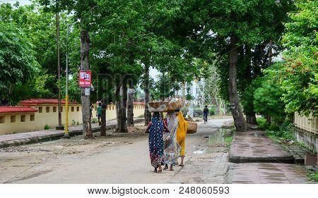 Bodhgaya, India - July 9, 2015. Women In Colorful Dress On Rural Road In Bodhgaya, India. Bodhgaya I