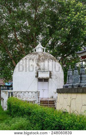 Bodhgaya, India - July 9, 2015. White Stupa Of Buddhist Pagoda In Bodhgaya, India. Bodhgaya Is The M