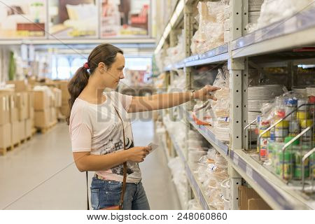 Beautiful Woman Shopping In Supermarket And Deciding What To Buy. Beautiful Woman Shopping In Superm