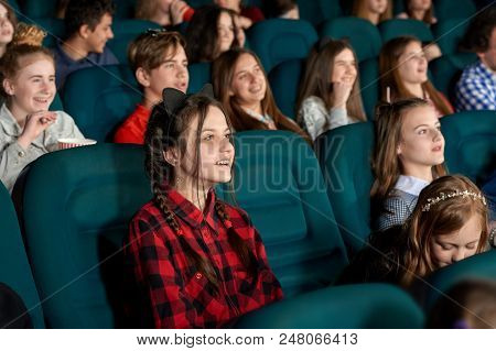 Beautiful Young Girl Watching Film With Steadfast Eyes And Smiling, Expressing Facial Emotions. Yout