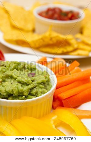 Guacamole And Salsa Dips A Starter Of Guacamole, Salsa And Different Dips Carrot, Pepper And Cucumbe
