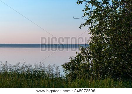 Shore Of The Lake In Windless Weather