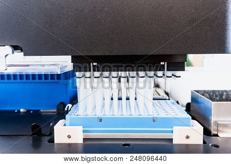 Automation in the clinical laboratory. Pipetting robot laboratory. Medicine robotics. NGS DNA diagnostics. Research and science background poster
