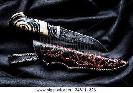 Hunter Knife With Wooden Handle On A Dark Background A
