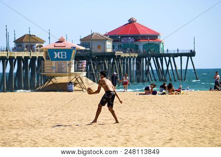 July 2, 2018 In Huntington Beach, Ca:  Man Playing Volleyball On The Sandy Beach With The Huntington