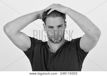 Guy With Bristle In Dark Blue Tshirt. Macho With Confident Face Holds Hands Behind Head. Man With Fa