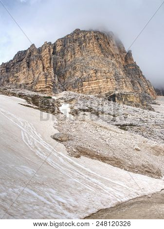 Misty Peak Of Sasso Di Landro,  Massive Tre Cime Di Lavaredo Rocks, Dolomites In Italy