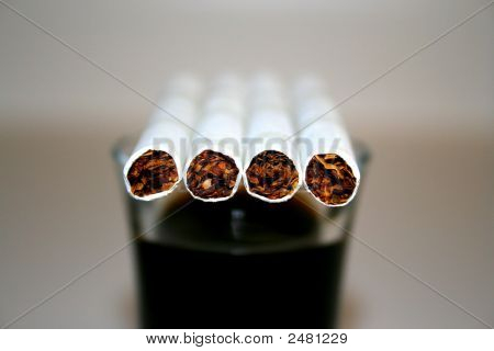 Cigarettes On A Glass