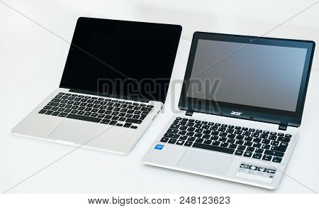 London, United Kingdom - Apple Mac Book Pro And Acer Aspire Laptop Notebook Next To Eachoterh On Whi