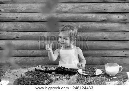 Country Life. Cute Little Boy With Blond Hair In White Pinafore Gives Thumb Up Hand Gesture Sign Of