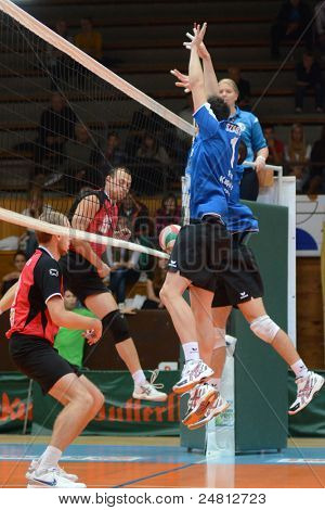KAPOSVAR, HUNGARY - OCTOBER 29: Alpar Szabo (blue 1) in action at a Hungarian National Championship volleyball game Kaposvar (blue) vs. Szolnok (red), October 29, 2011 in Kaposvar, Hungary.