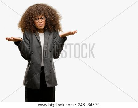 African american business woman wearing glasses clueless and confused expression with arms and hands raised. Doubt concept.
