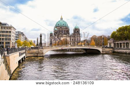 BERLIN, GERMANY-OCT 29, 2016:Beautiful view of Berliner Dom (Berlin Cathedral) at famous Museumsinsel (Museum Island) with excursion boat on Spree river in beautiful  Berlin on Oct29, 2016.. Germany..