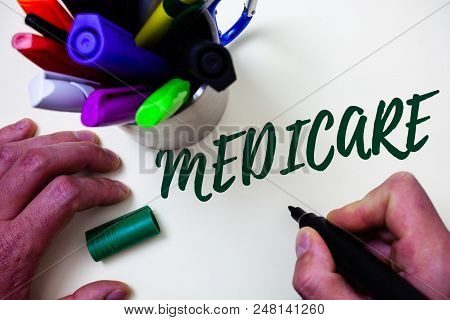 Word writing text Medicare. Business concept for Federal health insurance for people above 65 or with disabilities Artist study library colourful pen bunch handwritten beautiful script poster