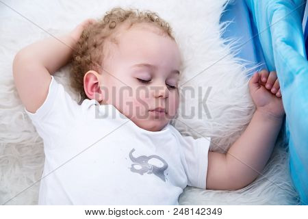Sleeping Baby Boy. Close-up Portrait Of A Beautiful Sleeping Baby Boy In Bed.  Newborn, Childhood Th