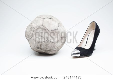 Black Old Ladies Shoe On High Heels On A White Background Whit An Leather Football