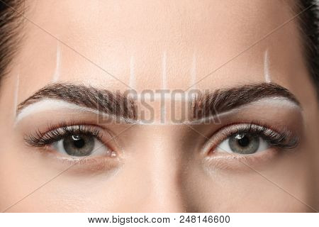 Young woman before procedure of eyebrows permanent makeup, closeup